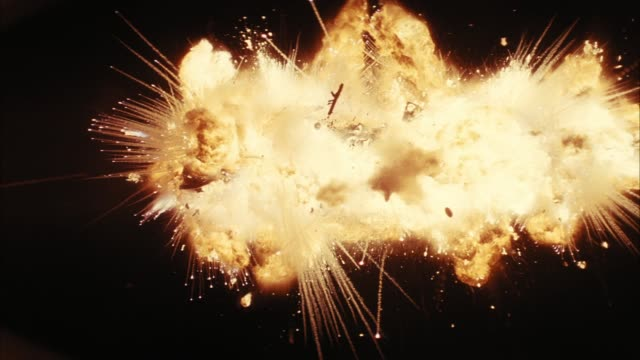 up angle of explosion in sky. could be airplane or helicopter. fire, flames, smoke. debris falling. playback. 5.1 stereo surround sound. 2904-002. - exploding stock videos & royalty-free footage