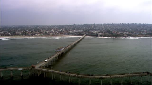 aerial of ocean beach municipal pier. pacific ocean. - san diego stock videos & royalty-free footage