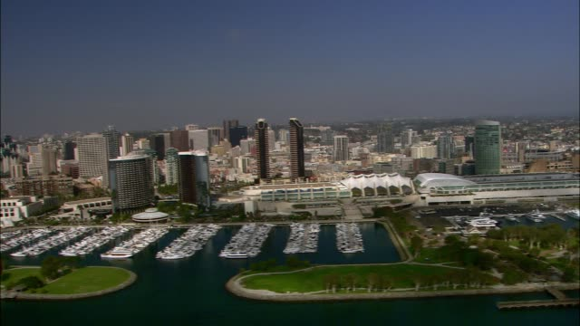 aerial of san diego city skyline. boats in marina. convention center. - san diego stock videos & royalty-free footage