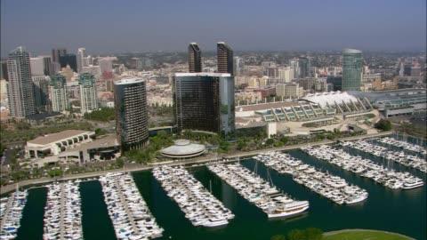 vidéos et rushes de aerial of san diego city skyline. boats in marina. - san diego