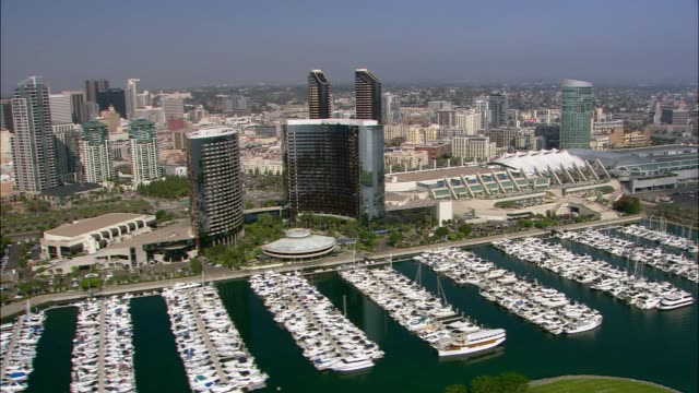 aerial of san diego city skyline. boats in marina. - san diego stock videos & royalty-free footage