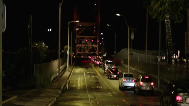 wide angle of cars in traffic at andrew mcardle, meridian st. bridge. drawbridge. - drawbridge stock videos and b-roll footage