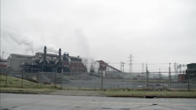 wide angle of gravel plant or factory. industrial building and area. - anno 2002 video stock e b–roll