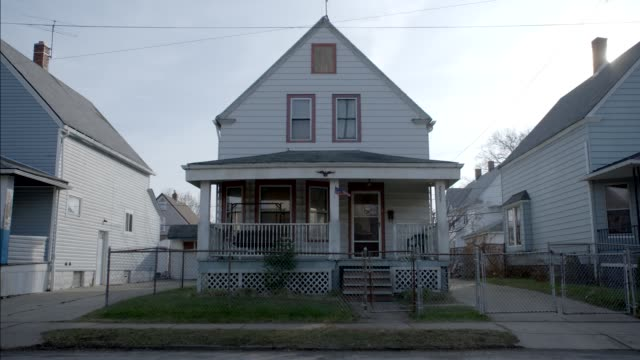 medium angle of two story lower class house. - cleveland ohio stock videos & royalty-free footage