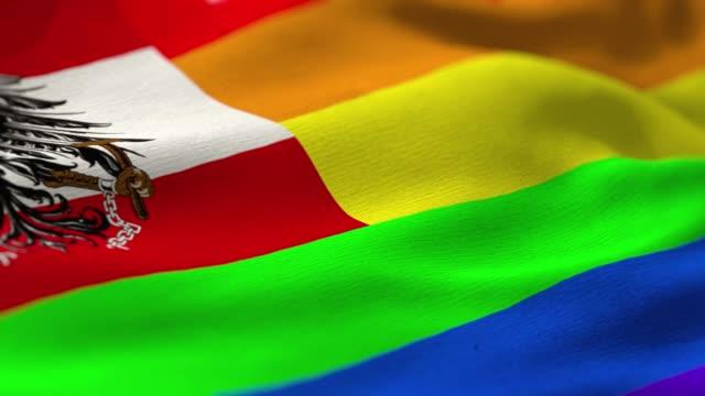 pride flag: austria - austria flag stock-videos und b-roll-filmmaterial