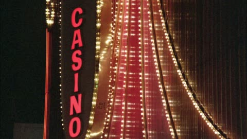 """medium angle of rotating neon sign with flashing lights that reads """"casino"""" on one side and """"slow"""" on other side. las vegas. - nevada stock videos & royalty-free footage"""