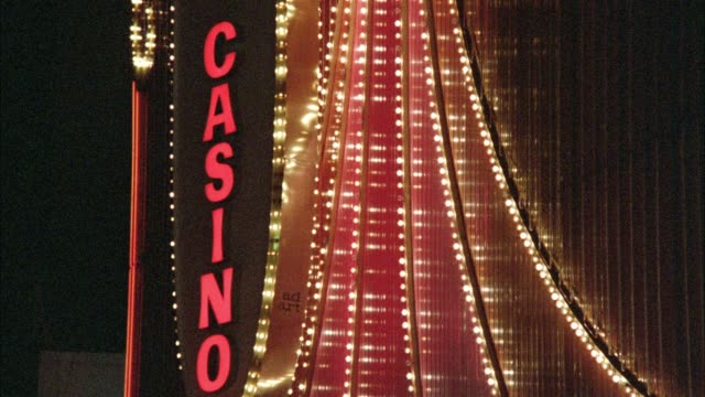 "medium angle of rotating neon sign with flashing lights that reads ""casino"" on one side and ""slow"" on other side. las vegas. - nevada bildbanksvideor och videomaterial från bakom kulisserna"