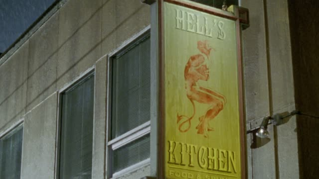 medium angle of sign for hell's kitchen restaurant or bar. rain. - hell stock videos and b-roll footage