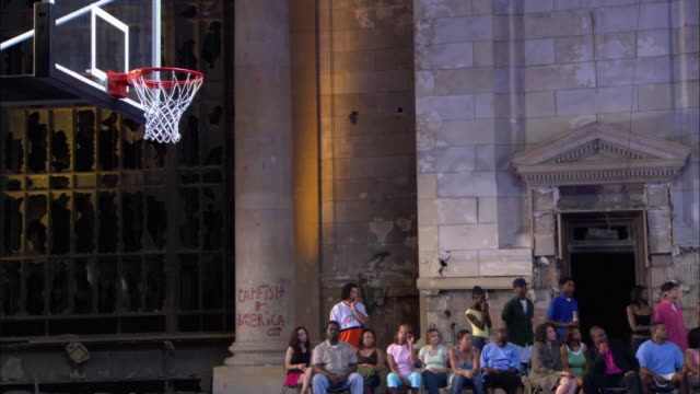 stockvideo's en b-roll-footage met medium angle of basketball court in makeshift gym or sports arena. crowds of men and women, spectators seen at sideline. - men
