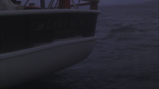 """close angle of hull of sailboat or other sailing vessel. inscription reads: """"lady jane, palm beach."""" see ocean or other large body of water rushing by. sailing. - other stock videos & royalty-free footage"""