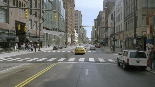 """wide angle driving pov straight forward through traffic on euclid ave in cleveland's warehouse district. high rise buildings, """"house of blues,"""" and """"the city club"""" seen. pov turns right to show pedestrians on sidewalk, storefronts, parking garage, rundown - armored truck stock videos and b-roll footage"""