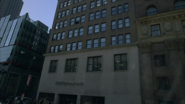 """wide angle moving pov straight left shows parking garage, construction site, high rise buildings on euclid avenue in downtown cleveland's warehouse district. passes rundown buildings with broken windows, banner advertising """"luxury condos,"""" """"flannigan's"""" i - ohio stock videos & royalty-free footage"""