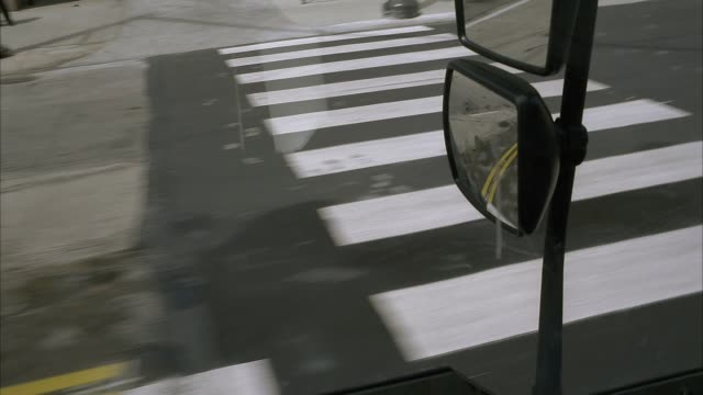 medium angle driving pov 3/4 left forward shows city street and side view mirrors reflecting road. vehicle passes parked cars, sidewalks, pedestrians and traffic. could be downtown. high pov and mirrors could be city bus, armored car, semi truck or eighte - armored truck stock videos and b-roll footage