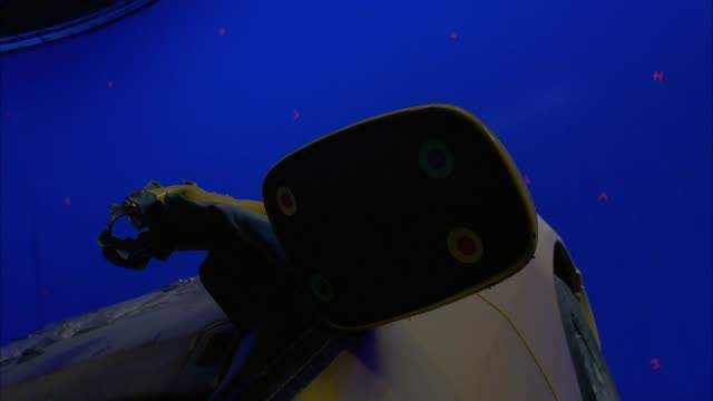 pull back from close angle of side view mirror without glass on model taxi with roof ripped off to show back of car at canted angle. model taxi is suspended in air by mechanical arm, blue screen in background. special effects. - blue glass stock videos and b-roll footage