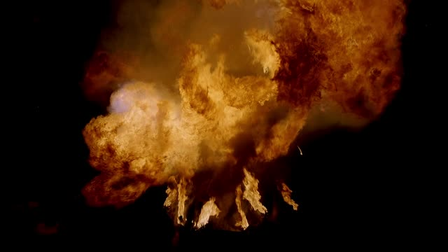 pull back through flames of  mushroom shaped fireball flares then burns nearly out. smoke, some sparks seen. special effect could be used for explosions. - sparks stock videos & royalty-free footage
