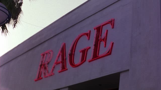 "WIDE ANGLE OF ""RAGE"" NEON SIGN FOR THE RESTAURANT, CLUB, AND BAR IN WEST HOLLYWOOD."