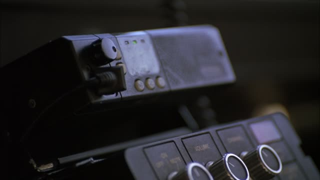 CLOSE ANGLE OF A CB RADIO OR POLICE CAR RADIO SPEAKER. COULD BE USED IN ANY POLICE OR TRUCK VEHICLE. ELECTRONICS.
