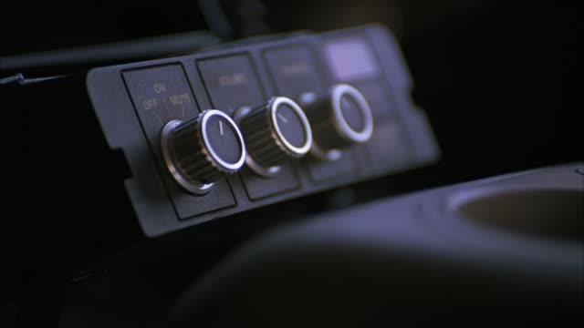CLOSE ANGLE OF A CB RADIO OR POLICE CAR RADIO CONTROLS. COULD BE USED IN ANY POLICE OR TRUCK VEHICLE. ELECTRONICS.