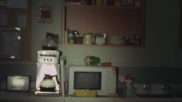 medium angle flashlight pov of blood splattered on wall and counter of kitchen. coffee maker and microwave visible. gore. crime scenes. murders. - taschenlampe stock-videos und b-roll-filmmaterial