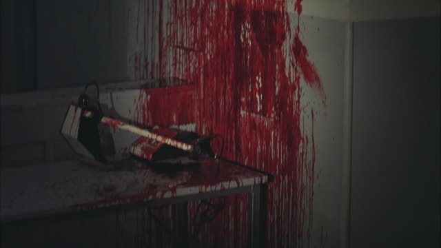 medium angle flashlight pov of blood splattered on wall and counter of kitchen. coffee maker and microwave visible. gore. crime scenes. murders. - microwave stock videos & royalty-free footage