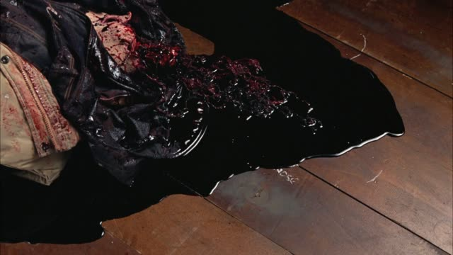 high angle down of dead body with brains and blood on wood floor. gore. - bloody gore stock videos & royalty-free footage