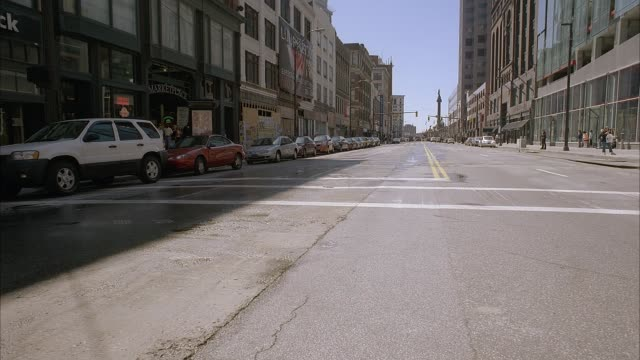 """wide angle from middle of cleveland city street intersection shows downtown high rises, boarded up rundown buildings and soldiers' and sailors' monument then turns 180 degrees to show """"the city club"""" and other brick buildings in cleveland's warehouse dist - ohio stock videos & royalty-free footage"""