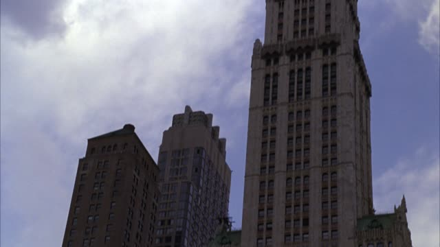 pan up of woolworth building. skyscrapers. office  buildings. - woolworth building stock videos & royalty-free footage