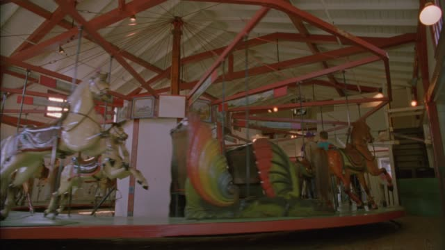 WIDE ANGLE OF MERRY-GO-ROUND, FLYING HORSES CAROUSEL IN OAK BLUFFS. MARTHA'S VINEYARD. NEW ENGLAND.