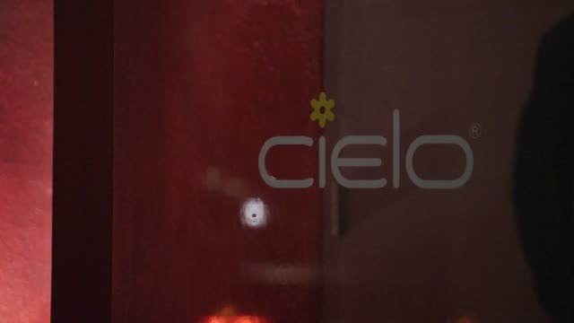 CLOSE ANGLE OF CIELO NIGHTCLUB SIGN ON DOOR. MEN AND WOMEN ENTER AND EXIT CLUB. BARS.
