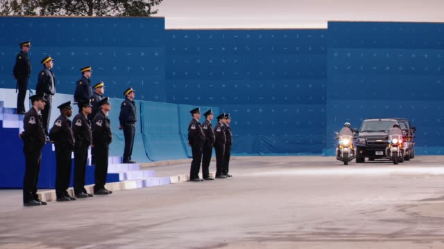 wide angle of presidential motorcade and escort. black suv approaches steps or stairs guarded by uniformed soldiers. blue screen. - motorcade stock videos & royalty-free footage