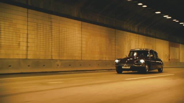 tracking shot of european car driving through tunnel and then getting thrown forward. could be for explosion. car accident or crash. car stunt. - stunt stock-videos und b-roll-filmmaterial