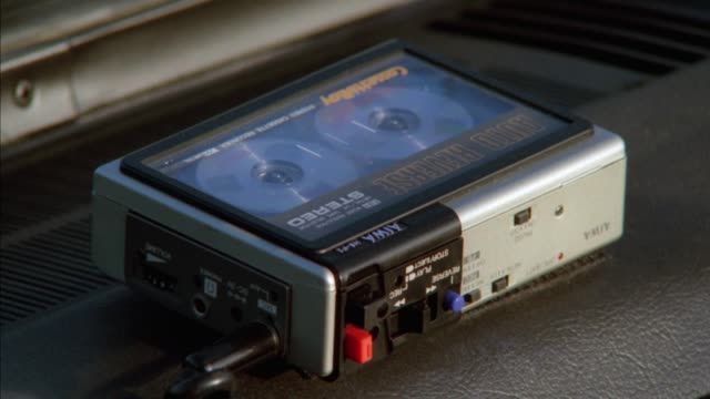 close angle of aiwa portable cassette player and stereo. tape can be seen playing in deck. - cassette tape stock videos & royalty-free footage