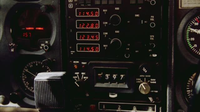 close angle of airplane instrument panel. see several digital meters and knobs. camera shakes as though plane is in movement. copilot joystick in right foreground shakes up and down. insert. - cockpit stock videos & royalty-free footage