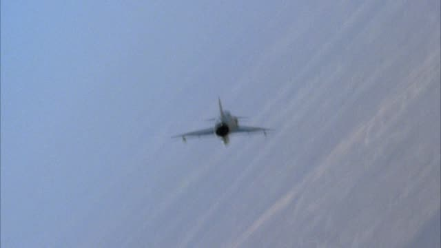tracking shot of saab viggen 37e jet fighter airplane engaged in dogfight maneuvers shot from behind jet tail and engine. see desert in background. see second jet to right of shot occasionally. action. middle east. - airplane tail stock videos and b-roll footage