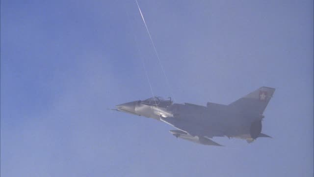 medium angle of saab viggen 37e fighter jet airplane model with strings attached. model explodes for visual or special effect. see debris flying. shot from behind engine of jet model. explosions. - special effect stock videos & royalty-free footage