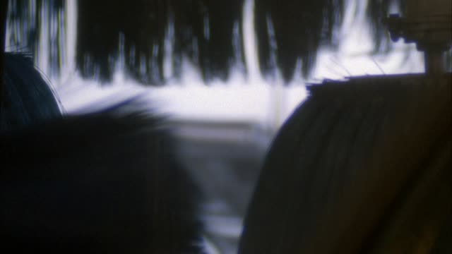 close angle of spinning black bristles on rotating brushes at car wash. insert. - car wash stock videos & royalty-free footage