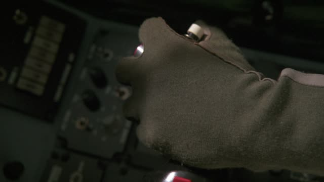 close angle of jet fighter yoke or controller stick. see pilots hand on yoke and pressing buttons repeatedly. neg cut. - cockpit stock videos & royalty-free footage