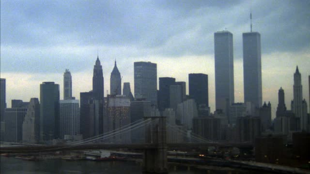 aerial of new york city skyline, lower manhattan. brooklyn bridge, east river, manhattan bridge in foreground.  world trade center, twin towers. - world trade center manhattan video stock e b–roll