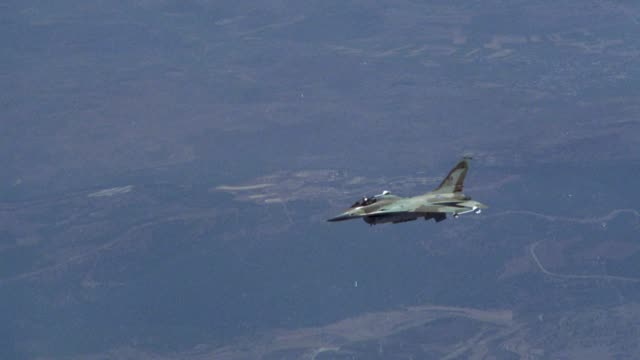 tracking shot of camouflage f-16 fighter jet flying. - fighter stock videos & royalty-free footage