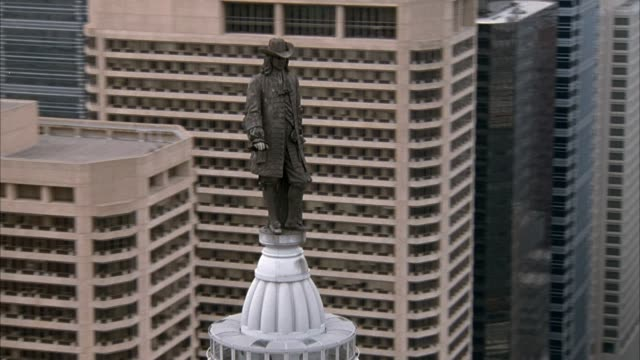 aerial of philadelphia city hall tower with statue of william penn. see city hall building below and see city skyline in background. - william penn stock videos and b-roll footage