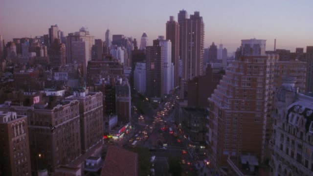 vidéos et rushes de wide angle of midtown and upper west side manhattan with high rise buildings. new york. city street in center of shot. - city street