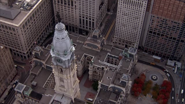AERIAL OF PHILADELPHIA SKYLINE, PANS LEFT AND DOWN TO STATUE OF WILLIAM PENN ON CITY HALL, CIRCLES TO RIGHT AROUND CITY HALL, THEN PANS UP AT END.