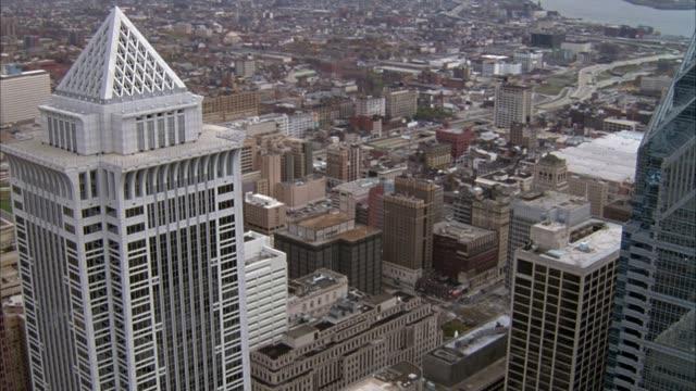 AERIAL OF PHILADELPHIA SKYLINE, PULLS BACK FROM MELLON BANK CENTER TO SKYLINE, POV MOVES BACK PAST WILLIAM PENN STATUE ON CITY HALL.