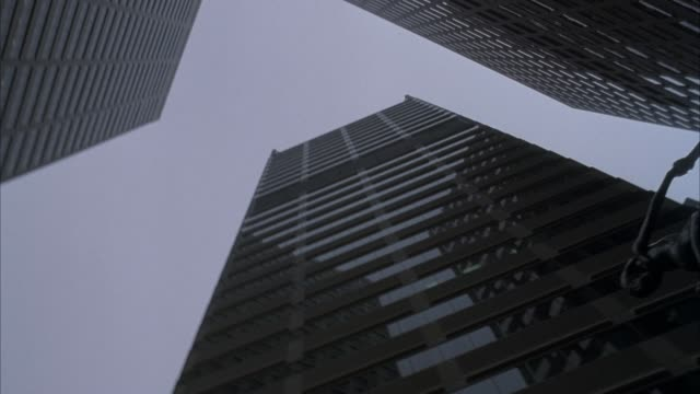 up angle of three william penn center high rise office buildings. pans down to bronze statue in plaza between buildings. - william penn stock videos and b-roll footage
