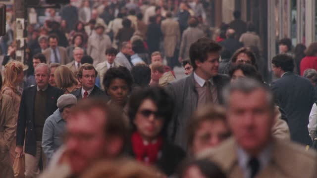 medium angle of crowd of pedestrians crossing street approaching front. see traffic pass by. sidewalks. people walking. manhattan. - pavement stock videos & royalty-free footage