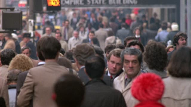 "medium angle of crowd of pedestrians crossing street approaching front. see ""don't walk"" sign flashing and ""empire state building"" on awning. entrance sign. traffic passes in background in between crowd. - 1984 stock videos & royalty-free footage"