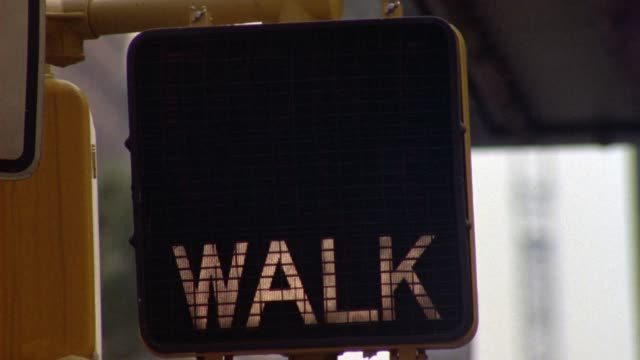 "close angle of crosswalk street sign flashing ""walk"" and ""don't walk"" in green and red. insert. neg cut. - road sign stock videos & royalty-free footage"