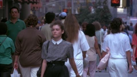 medium angle of crowds of people walking down sidewalk. - 1990 stock videos & royalty-free footage
