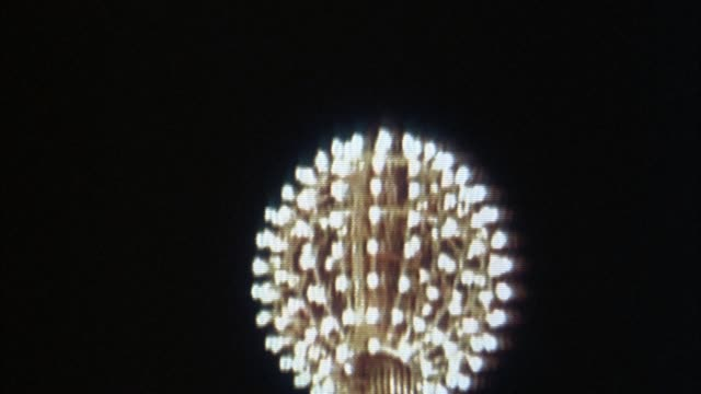 "close angle of television screen with ""live"" broadcast of times square ball dropping on new year's eve. cuts to shots of crowds cheering and fireworks exploding. explosions. - 1990 stock videos & royalty-free footage"