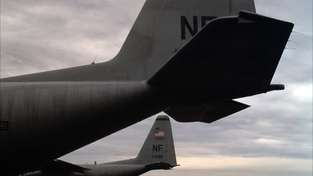 close angle of two military airplane rudders. see american flag on tail of one. could be army or air force. - airplane tail stock videos and b-roll footage